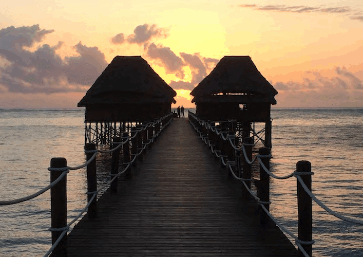 Beach bungalows at the end of a pier