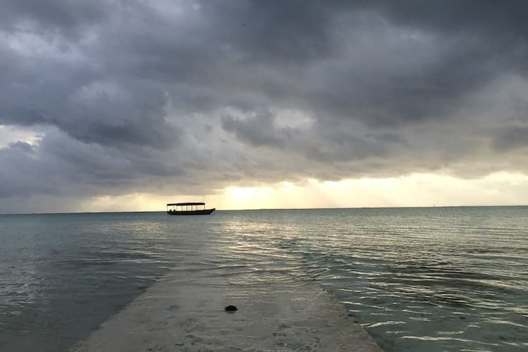 Boat under storm clouds