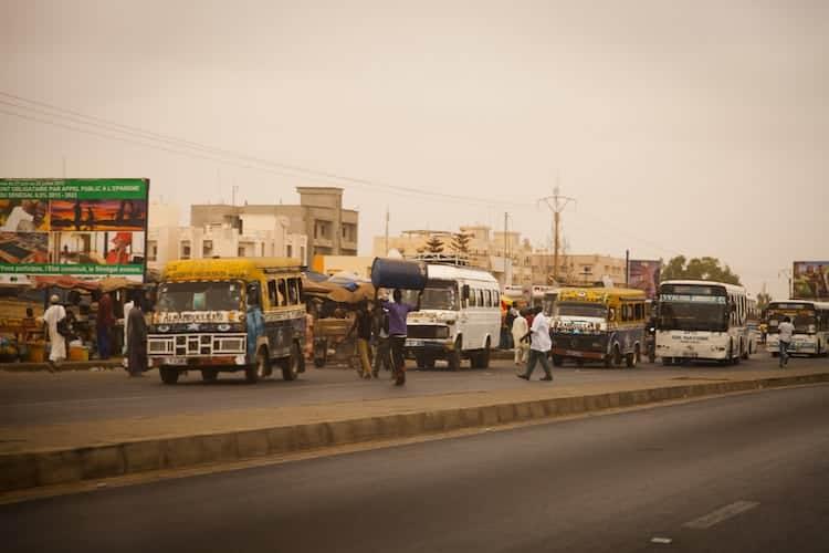 People getting on busses in Senegal
