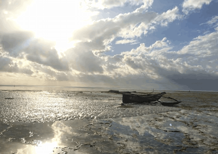 Boat stranded on the shore during low tide