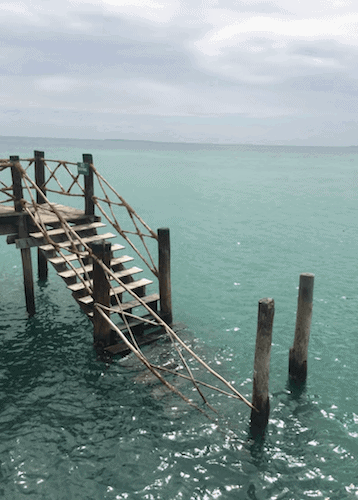 Wooden steps down into the ocean
