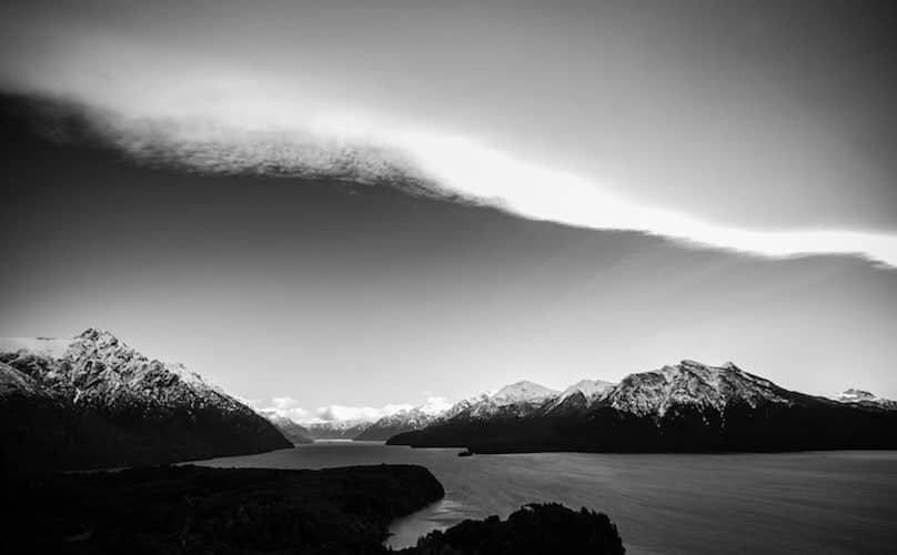 Winding river below mountain, Chile